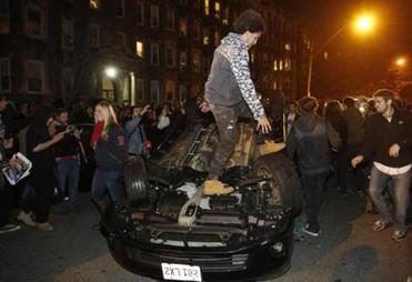 Duncan said he learned from police and videos online that revelers overturned his car.  (Jessica Rinaldi For The Boston Globe)